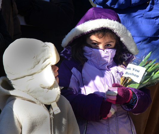 Newbury: Jessica Simmons, 6, on the right,along with her sister Angela,5, holds a flowers with a card that read Thank You Mrs Bushee at a Memorial for the Bushee home that was demolished Thursday on Newman Road in Newbury. Jim Vaiknoras/staff photo