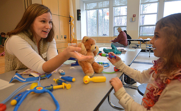 "Salisbury: Stacey Allaire helps Sheayla Capuci. 6. give her bear ""Cutie"" a flu shot at the Teddy Bear Clinic at Salisbury Elementary School Saturday. the event sponsered by The Anna Jaques Hospital drew over a hundred kids and their bears. Jim Vaiknoras/staff photo"