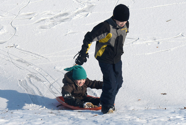 Newburyport: Oliver Stevenson, 5, gets a lift from his brother Nolan 12, as they sled on the Bartlett Mall Sunday afternoon.