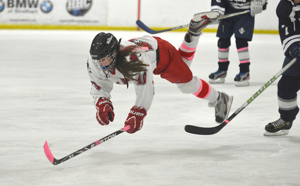 Newburyport: Masco player Dana Valletti of Hamilton-Wenham is tripped by  a Medford player off the puck during their game at the Graf Rink in Newburyport Wednesday night. Jim Vaiknoras/staff photo