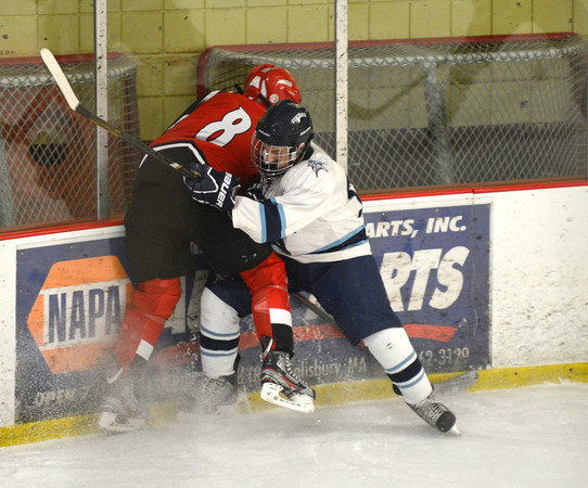 Newburyport: Amesbury's Andrew Reidy checks Tritons's Zack D'Agostino during heir game Saturday at teh Graf Rink in Newburyport. Jim Vaiknoras/staff photo