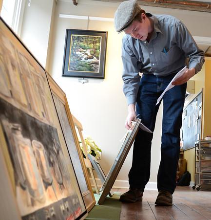 Newburyport: Lucas Spivey judges the Newburyport Art Association winter show. JIm Vaiknoras/staff photo