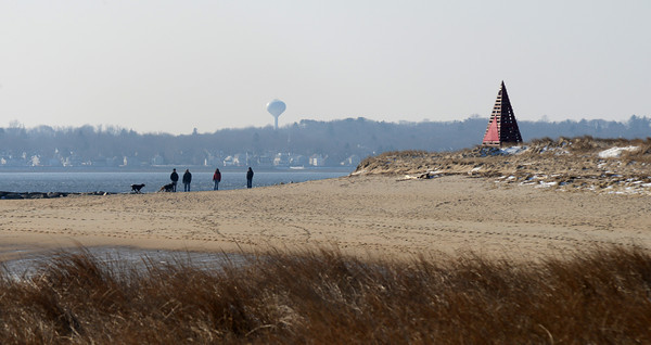 Salisbury: People and their dogs enjoy a quiet afternoon at Salisbury Beach Reservation Sunday. JIm Vaiknoras/staff photo