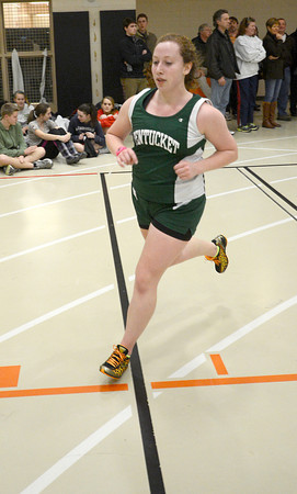 Ipswich: Pentucket's Alana D'Olimpio run the 2 mile at a track meet at Ipswich High Tuesday. Jim Vaiknoras/staff photo
