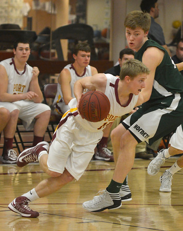 Newburyport:Newburyport's Adam Traxler drives by a Manchester-Essex player during their game at Newburyport high Friday night. Jim Vaiknoras/staff photo