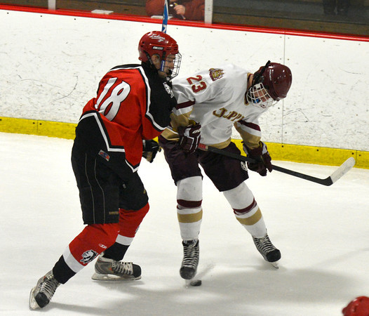 Newburyport: Amesbury's Justin Irving fights  Newburyport's Matthew Kelleher for the puck during their game at the Graf Rink in Newburyport Saturday night. Jim VAiknoras/staff photo