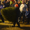 Newbury: Luke Young, 11, takes his turn at the tree toss at the annual Christmas Tree bonfire Saturday night in Newbury. Jim Vaiknoras/staff photo