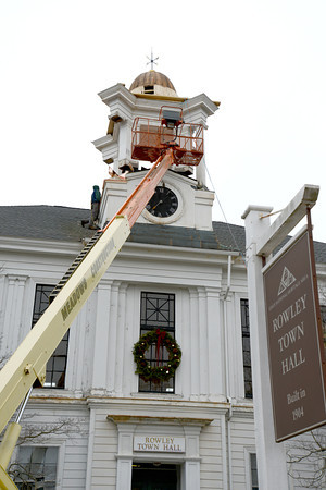 Rowley:  Workers from Meadows Construction repair the cupola on the Town Hall building in Rowley.  Another contractor, A.J. Wood Construction, will soon be replacing the windows in the building.  The updates  were made possible by funding, about $150,000 total for both jobs, from the town's Commmunity Preservation Committee, which was approved by voters at Town Meeting<br /> Jim Vaiknoras/staff photo