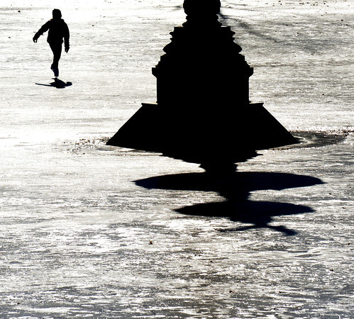 Newburyport: A skater casts a shadow minicing the shadow cast by the swan fountain at the Mall in Newburyport Sunday afternoon. Jim Vaiknoras/staff photo