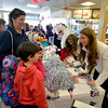 Seabrook: New England Patriot's Cheerleaders Alanna Perry of Andover and Brittany Stanley of Nashua sign posters for Vincent Simonelli, 9, his sister Gianna , 8, and his mom Debbie at the Seabrook One Stop Friday. The cheerleaders were there as part of a promotion for the Patriots lottery ticket. Jim Vaiknoras/staff photo