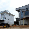 Newbury: Workers shore up the beach in front of Annapolis Way on Plum Island Friday afternoon. Jim Vaiknoras/staff photo
