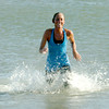 Salisbury: Sheri Marshal kicks up some water as she swims at Salisbury Beach after running the Winner's Circle New Year's Classic Tuesday. Jim Vaiknoras/staff photo