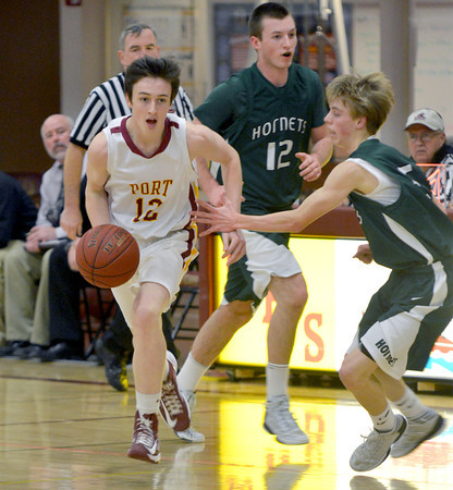 Newburyport:Newburyport's Dan Baribeault drives by Manchester-Essex player Petey Morton during their game at Newburyport high Friday night. Jim Vaiknoras/staff photo