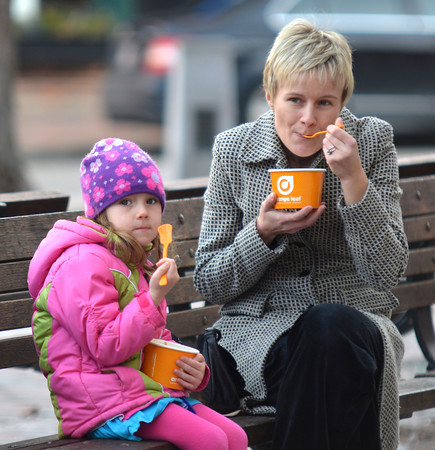 Newburyport: Sofia Hellstrom ,4, and her mom Linda enjoy some frozen yogurt on not so frozen winter day in Market Square in Newburyport Sunday. Jim Vaiknoras/staff photo