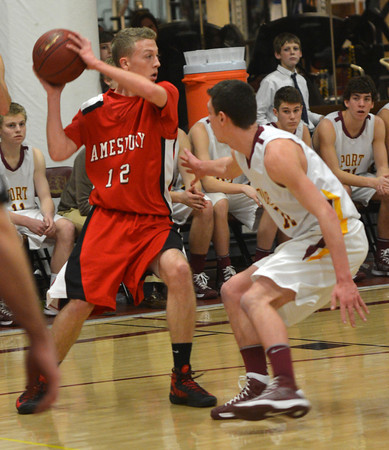 Newburyport: Amesbury's Jack Fortin looks to pass while being guarded by Newburyport's Ian michaels  during their game at Newburyport High Friday night. JIm Vaiknoras/staff photo