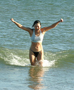 Salisbury: Sung Yun of Boston celebrates a cold swim at Salisbury Beach after running the Winner's Circle New Year's Classic Tuesday. Jim Vaiknoras/staff photo
