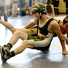 Byfield: Pentucket's Mike Sullivan is thrown by Lynnfield's Joe Wise in their 126 lb match at the Cape Ann League wrestling championships at Triton Saturday. Jim Vaiknoras/staff photo
