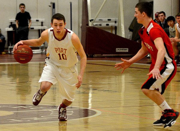 Newburyport: Newburyport's Ian Michaels brings the ball up against Amesbury's Thomas Connors during their game at Newburyport High Friday night. JIm Vaiknoras/staff photo