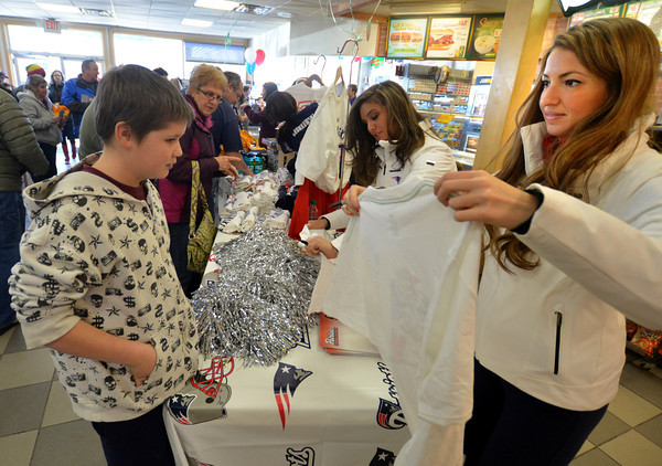 Seabrook: New England Patriot's Cheerleaders Alanna Perry of Andover and Brittany Stanley of Nashua sign a shirt for David Fowler of Seabrook at the Seabrook One Stop Friday. The cheerleaders were there as part of a promotion for the Patriots lottery ticket. Jim Vaiknoras/staff photo