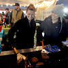 Newbury: Kendall Bowie and Kyree Gerson of Mad Martha on Plum Island flip burgers at the annual Christmas Tree bonfire Saturday night in Newbury. Jim Vaiknoras/staff photo
