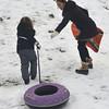 Newburyport: Martha Trail helps her daughter Shay, 8, up Marches Hill in Newburyport Thursday afternoon. Jim Vaiknoras/staff photo