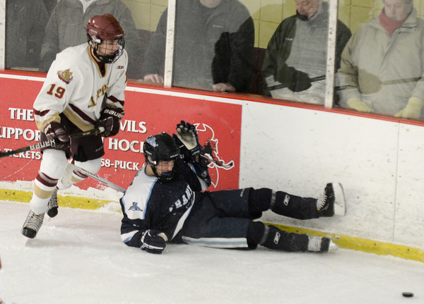 Newburyport: Newburyport's Nicholas Federico knocks down a Franklin player during their game at the Graf Rink in Newburyport Saturday. Jim Vaiknoras/staff photo