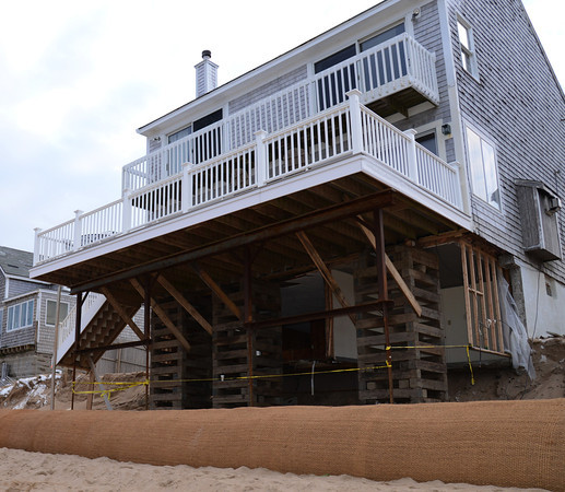 Newbury: Temorary wooded bracing supports a home on Annapolis Way on Plum Island Friday afternoon. Jim Vaiknoras/staff photo