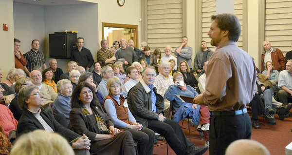 Newburyport: Geordie Vining answers questions about the waterfront development at an NRA meeting at the Newburyport Library Wednesday night. Jim Vaiknoras/Staff photo