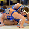 Byfield: Georgetown's Mike Gallanan gets an advantage on Danvers'sDan Papeselis in their 126 lb match at the Cape Ann League wrestling championships at Triton Saturday. Jim Vaiknoras/staff photo