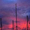 Newburyport:Saturday evening sunsets turn the sky red and purple behind sailboat mast at the Windward Yacht Club. Jim Vaiknoras/staff photo