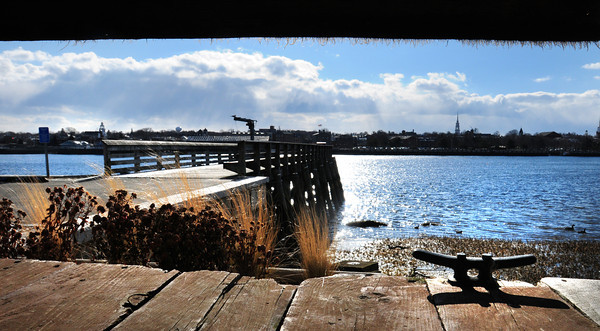 Newburyport: The Newburyport skyline and Salisbury Town Pier on Ring's Island is framed by boat docks stored there, the boating season seeming very far off with this week's sub-freezing temperatures and wind. Bryan Eaton/Staff Photo