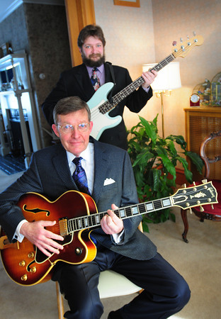 Amesbury: Funeral directors Paul Rogers, front, and his son Cyrus have a serious job running four funeral homes, but in their off time they play in rock and jazz bands in the area. Bryan Eaton/Staff Photo