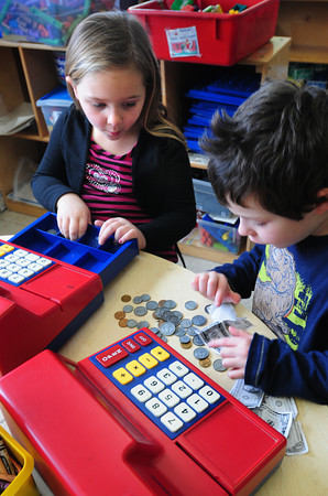 "Amesbury: Brianna Yates, left, and Jeffrey Wolk, both 5, count fake money as they, in their words, ""play cash register."" They were in ""free time"" in Sharon Nash's kindergarten class at Amesbury Elementary School. Bryan Eaton/Staff Photo"