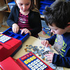 """Amesbury: Brianna Yates, left, and Jeffrey Wolk, both 5, count fake money as they, in their words, """"play cash register."""" They were in """"free time"""" in Sharon Nash's kindergarten class at Amesbury Elementary School. Bryan Eaton/Staff Photo"""