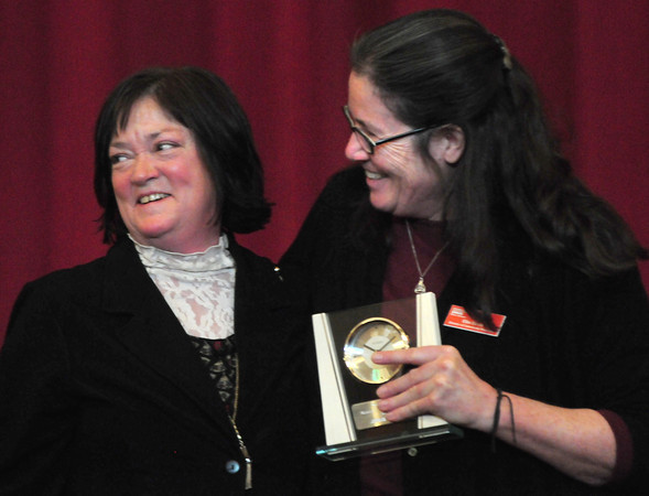 Newburyport: YWCA Director of Programs and Community Relations, Ellie Davis, right, presents Nancy Earls the Nancy E. Peace Action Against Prejudice Award at the YWCA's 20th Annual Martin Luther King Breakfast. Bryan Eaton/Staff Photo