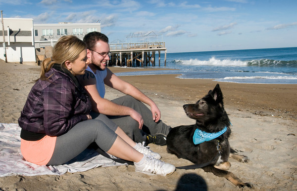 Salisbury: Jessica and Adam Nadeau of Chelmsford took their blanket and dog, Nicky, to spend some time at Salisbury Beach as the temperature was a little shy of 60 degrees. More seasonal weather returns as we get closer to the weekend. Bryan Eaton/Staff Photo