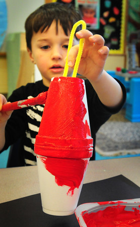 Newbury: Harrison Pike, 5, paints his Chinese lantern Tuesday afternoon in Mary Jo Lagana's preschool class at Newbury Elementary School. The children have been learning about China and will be celebrating their new year in two weeks, this year is the year of  the snake. Bryan Eaton/Staff Photo