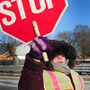 Newburyport: Newburyport Schools crossing guard Peggy Lysik is dressed for the cold as she stops traffic at Route One and Low Street on Thursday afternoon. Temperatures begin to warm over the weekend with temperatures climbing close to 50 degrees on Wednesday next week. Bryan Eaton/Staff Photo