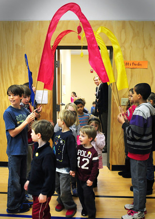 "Newburyport: Selected students at the River Valley Charter School in Newburyport hold banners as younger schoolmates walk into the gymnasium Friday for an assembly. The event "" A Place and Promise for our Future"" was to celebrate the charter school's purchase of the building they've been in since 1999. Bryan Eaton/Staff Photo"