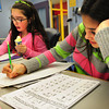 Salisbury: Avarey Caron, 10, left, and Jannelle Divincenzo, 11, both work on fractions and multiplication in the homework room at the Boys and Girls Club. Students get points for attending and behaving appropriately with a chance to host a pizza party at the end of every month. Bryan Eaton/Staff Photo