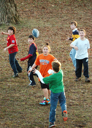 Newburyport: The YWCA Afterschool program took some of their activities outside to the Bartlet Mall yesterday during the unseasonably warm weather. These youngsters played touch football while others went the the Kelley School playground equipment. Bryan Eaton/Staff Photo