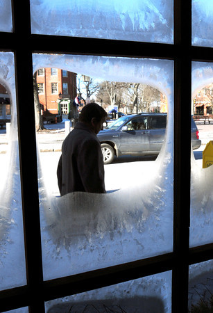 Newburyport: Frozen windows in downtown Newburyport framed passersby who ventured into the Market Square on Thursday. Bryan Eaton/Staff Photo
