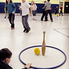 "Amesbury: Children play ""Snowball"" in Margaret Welch's physical ed. class at Amesbury Elementary School on Wednesday morning. Each team tries to defend the opposing one from toppling the pin with their snowballs. Bryan Eaton/Staff Photo"
