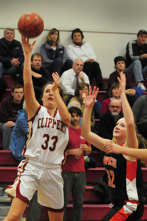 Newburyport: Newburyport's Mary Pettigrew comes up short on a basket as she shoots past Ipswich's Julia Davis. Bryan Eaton/Staff Photo