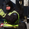 Newburyport: Police officer Bill McAdams is dressed for the frigid weather as he directed traffic at a utility detail on Merrimac Street in Newburyport yesterday. The temperatures will remain cold not rising above freezing until Sunday or Monday. Bryan Eaton/Staff Photo