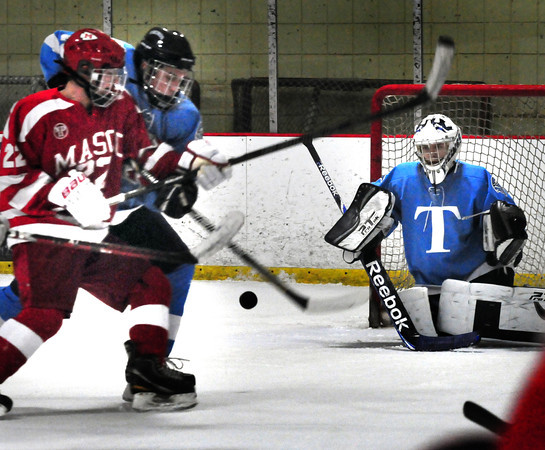 Newburyport: Triton's Andrew Sheerin checks Masconomet's Stephen Pease after he shoots as unsuccesful shot against Triton goalie Devon Shuman. Bryan Eaton/Staff Photo