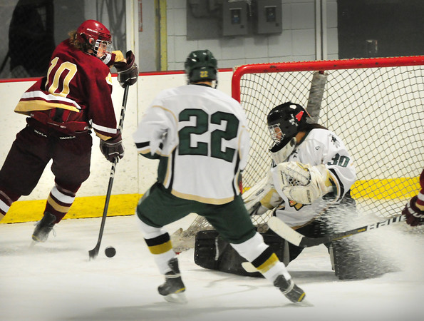 Haverhill: Pentucket goalie Sammantha Bomba reacts to a shot on net by Newburyport's number 10 last night in Haverhill. Bryan Eaton/Staff Photo