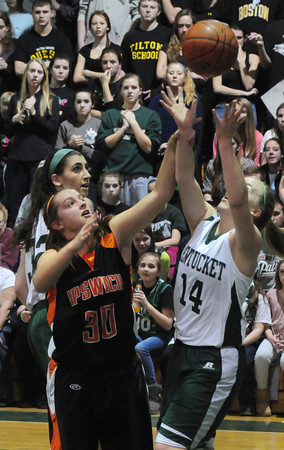 West Newbury: Ipswich's Bridget Curran and Pentucket's Nicole Viselli go for a rebound. Bryan Eaton/Staff Photo