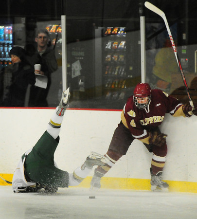 Haverhill: Newburyport's Jayson Dylingowki collides with a Pentucket player last night in Haverhill. Bryan Eaton/Staff Photo