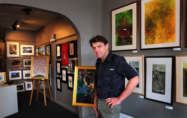 Amesbury: Jon P. Mooers has opened a gallery in downtown Amesbury to showcase fellow local artists' work. Bryan Eaton/Staff Photo